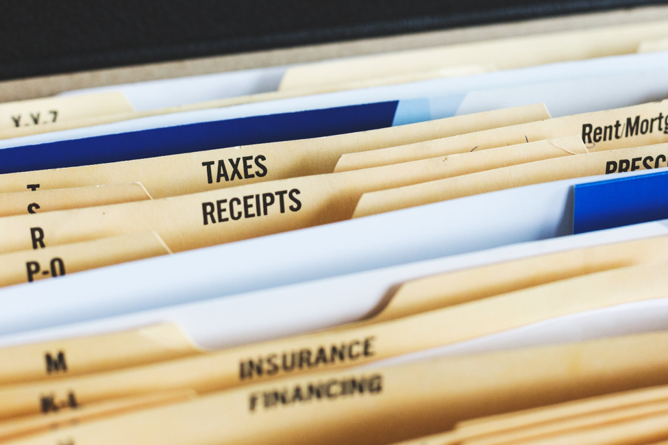 file folders showing taxes and receipts