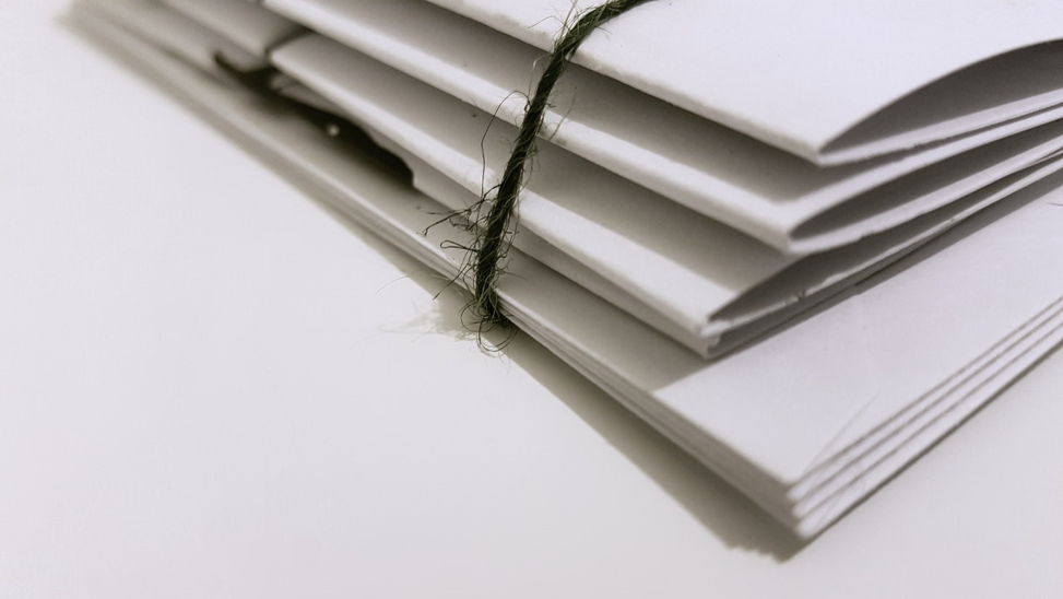 a set of emergency loans online documents tied together