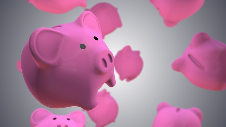 pink piggy banks with black eyes floating through grey space